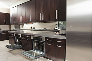 Commercial Kitchen With Open Oven And Cabinets